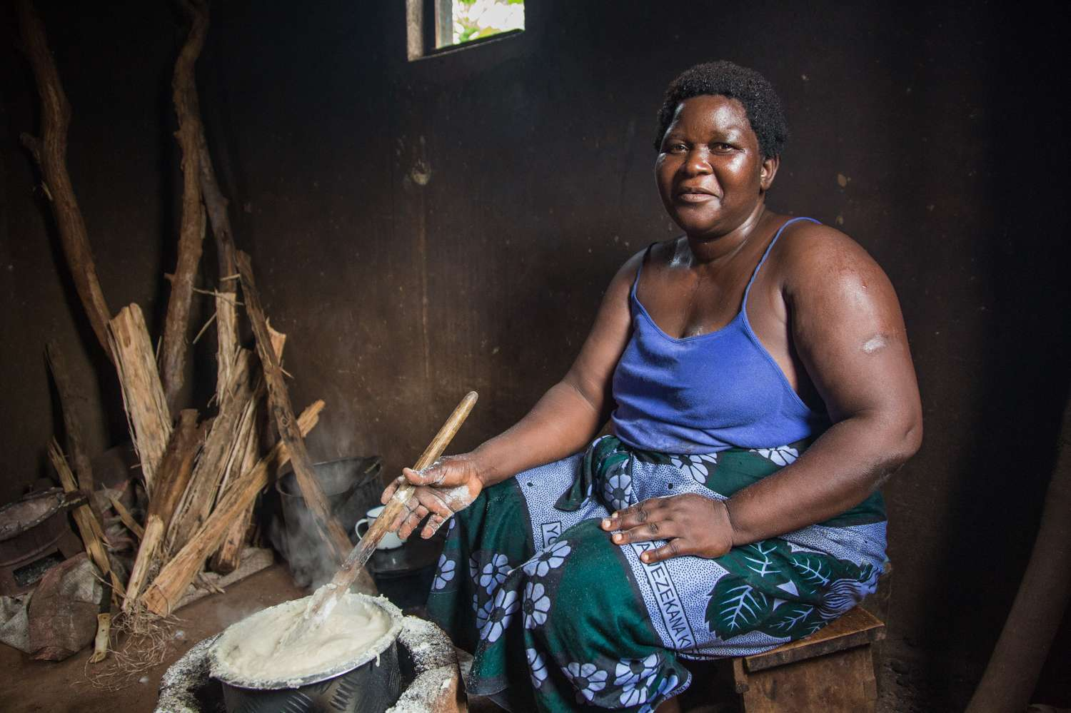 Rose Kandodo, from Nessa near Mulanje, has just finished cooking the staple food Nsima.