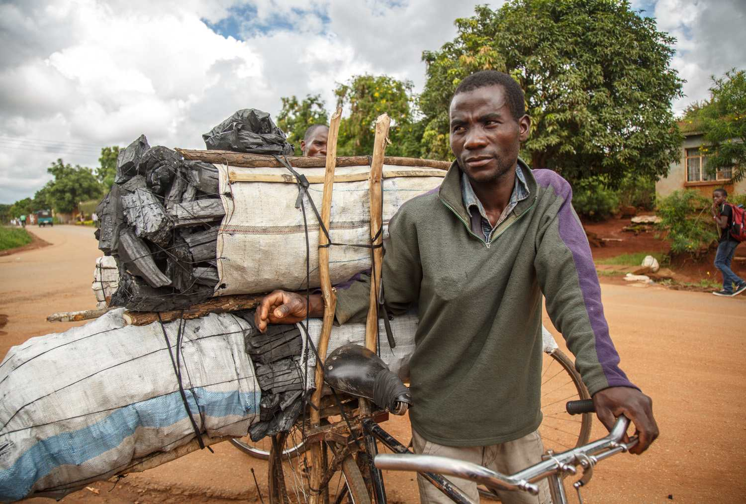 Mr Marino has been pedalling all through the night to reach Lilongwe with bags of charcoal that weigh 50 kg or more each.