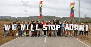 Protesters, including First Nations people, blocking the road to Adani's Abbott Point coal port.