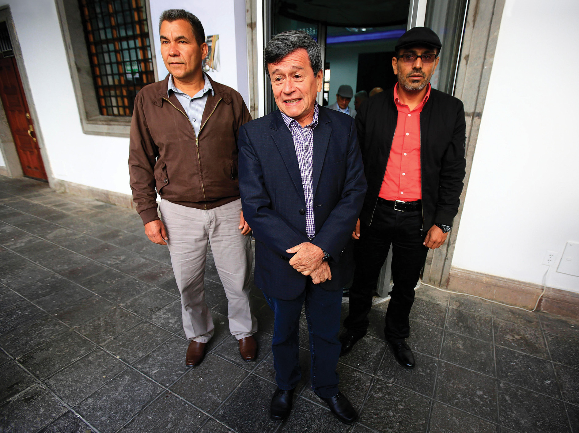 Pablo Beltrán and others in the ELN's peace delegation address the media during talks in Quito earlier this year.