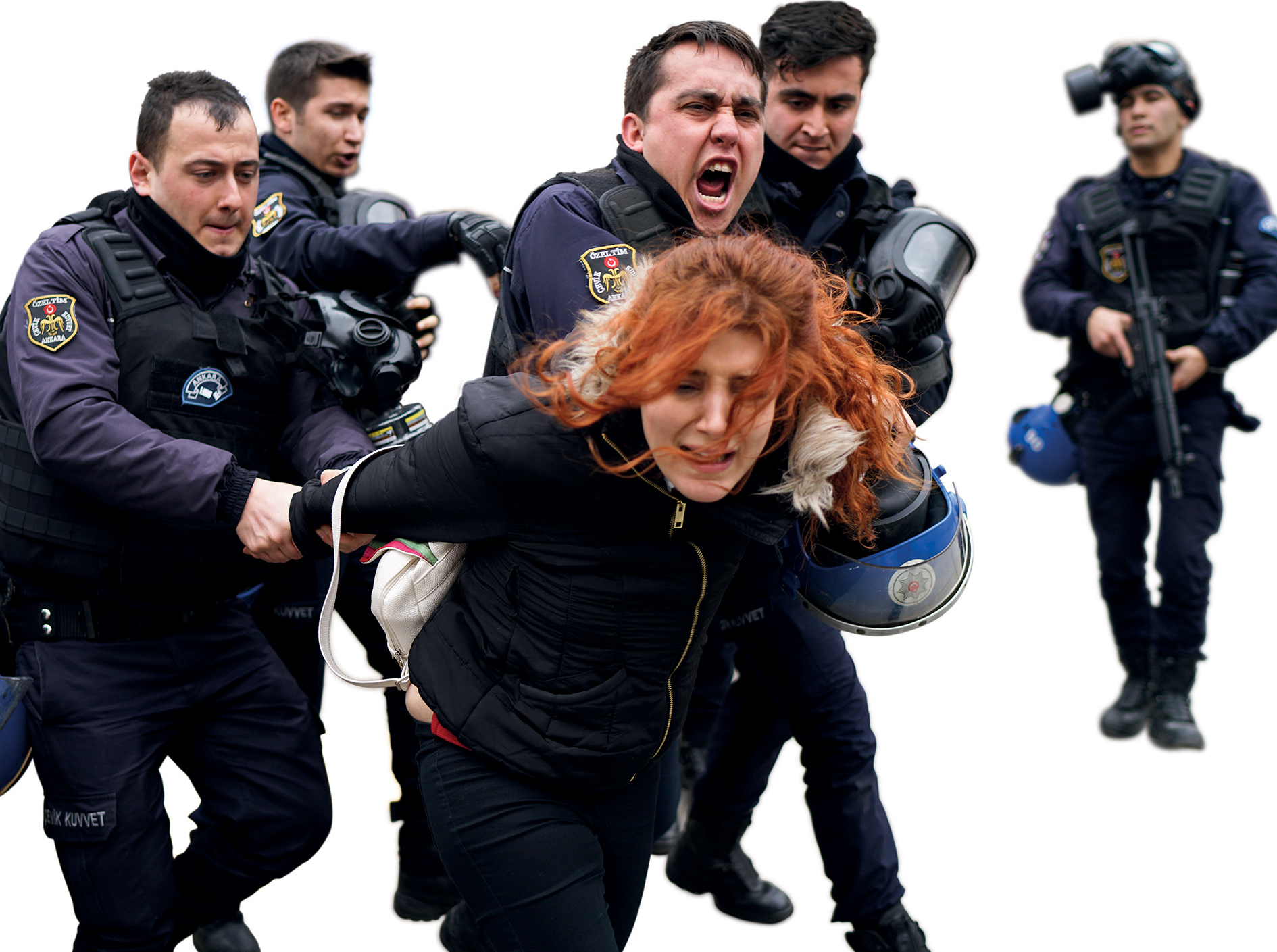 Turkish riot police crack down on people protesting against the purge of academics, outside Ankara University.