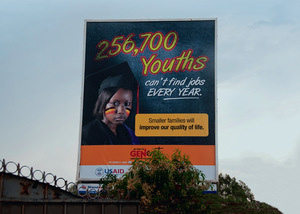 A public billboard produced by the Uganda Health Marketing Group.Photo: Jenny Matthews / Panos