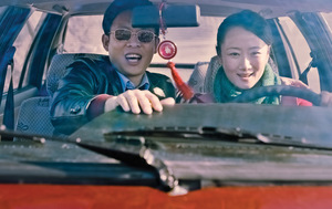 Liangzi woos Tao, with the help of  a BMW, in Jia Zhangke's brilliant Mountains May Depart.