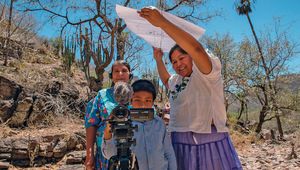 Anabela (right) provides shade during a participatory video session.