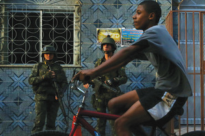 Police can feel like an occupying force in Rio de Janeiro's favelas. Photo: Valery Sharifulin/ITAR-TASS/Alamy