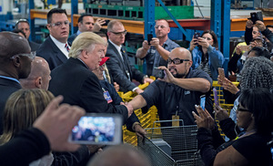 Donald Trump greets workers on a tour of Carrier Corporation in Indianapolis, Indiana on 1 December 2016.