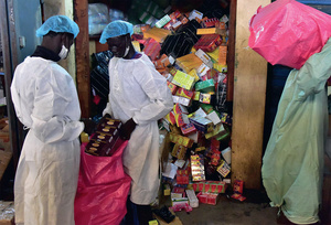 Health Ministry employees empty a shop selling fake medicine in Abidjan, Côte d'Ivoire.