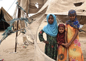 These three Yemeni girls are among the 3.1 million people displaced by the war. They stand by the shredded remains of their tents in Abs settlement, which is regularly damaged by passing sandstorms.
