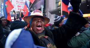 An attendee of the Rally Against Racism: Stand up for Haiti and Africa march, New York,  15 January 2018.Photo: Timothy A Clary/AFP/Getty