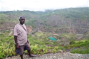 Philip Miriori stands over the gaping wound that is Panguna Mine – the largest open-cut copper mine when in operation.