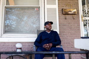 Julius sits on the porch of his house in Trenton, New Jersey, looking north at Ewing Township where foreclosure rates are drastically lower.Photo: Jack Crosbie