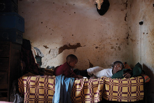 Passing the time at an orphanage outside Kampala, Uganda.Photo: ZUMA Press / Alamy