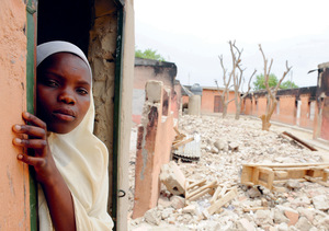A student looks out from the remains of a classroom destroyed by Boko Haram in Maiduguri, northeast Nigeria.