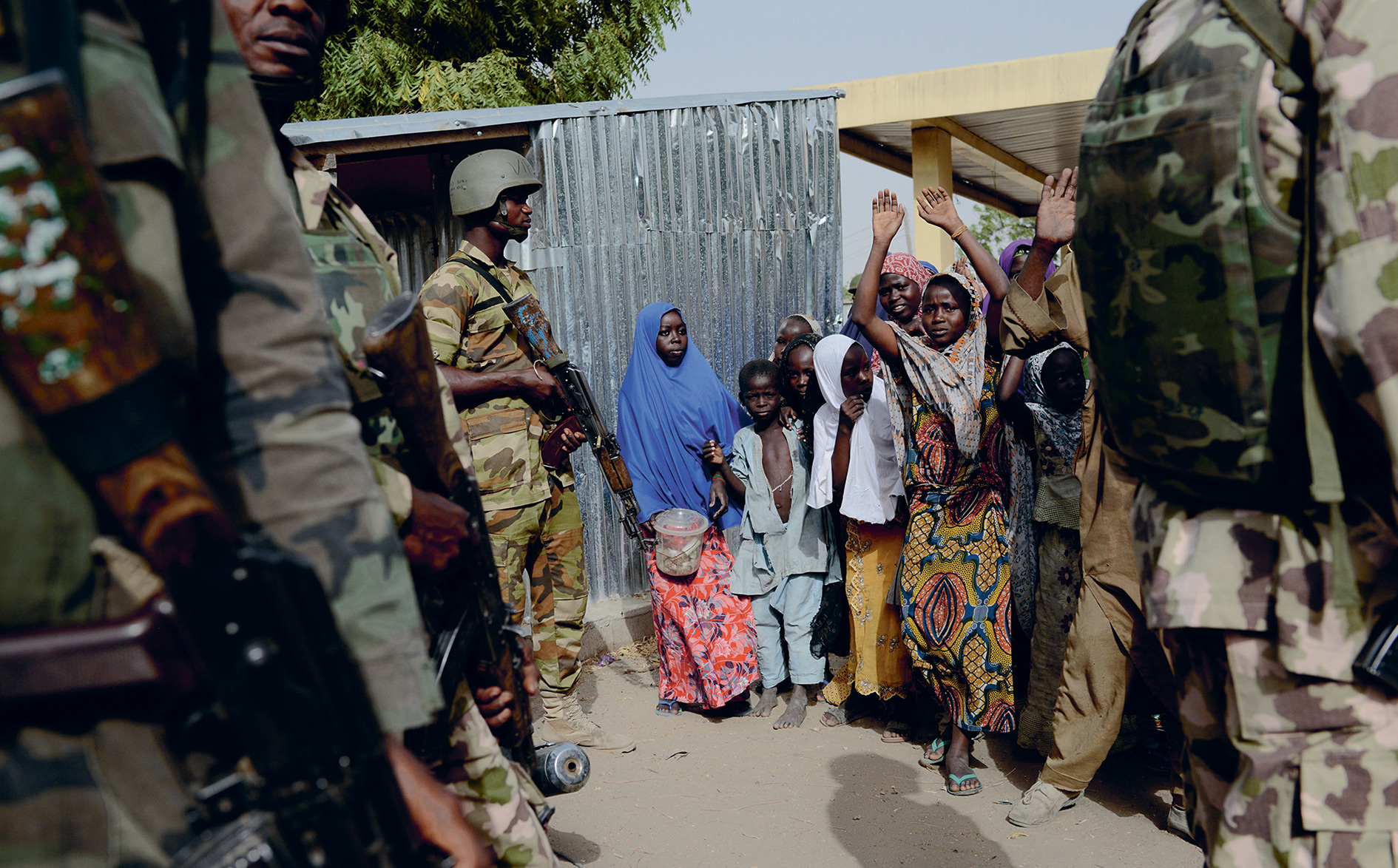 Free at last? The Nigerian military is greeted by people in Monguno town after driving out Boko Haram in 2015.