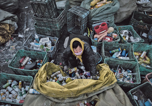 The face of plastic recycling that China wants to change. A worker sorts plastic in Dong Xiao Kou, a 'scrap village' on the outskirts of Beijing where poor migrant families survive from recycling rubbish.Photo: Kevin Frayer/Getty