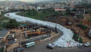A river of bin bags snakes down the road  in Jdeideh, Beirut, at the height of the rubbish crisis in February 2016. Photo: Hasan Shaaban/Reuters