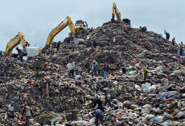 Like a scene from a blockbuster epic on trash: people search for pickings in the Indonesian capital Jakarta's Bantar Gebang dump. Over 60 per cent of the waste is organic and could be composted, but there is no large-scale sorting of refuse, making it much harder to manage. Photo: Bay Ismoyo/AFP/Getty
