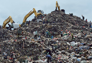 Like a scene from a blockbuster epic on trash: people search for pickings in the Indonesian capital Jakarta's Bantar Gebang dump. Over 60 per cent of the waste is organic and could be composted, but there is no large-scale sorting of refuse, making it much harder to manage.Photo: Bay Ismoyo/AFP/Getty