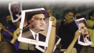 Still a hero? Demonstrators protesting against this year's election results hold aloft photos of former president Nasser.