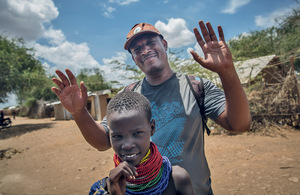 Tolossa Asrat, editor of Kanere, poses with a local Turkana girl in Kakuma refugee camp, northwest Kenya.Photo: Sally Hayden