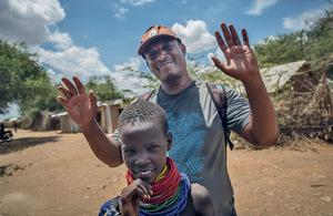Tolossa Asrat, editor of Kanere, poses with a local Turkana girl in Kakuma refugee camp, northwest Kenya.Photo: Sally Hayden