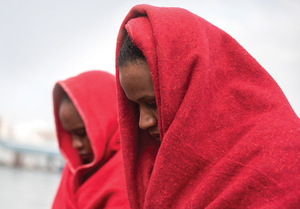Rescued but fearful: these are images of sub-Saharan women brought ashore from the Alboran Sea to the port of Motril near Granada by maritime rescue teams. Whether draped in red blankets or clinging fast to a railing after their time on the waves, uncertainty is written on every face.Photo: CARLOS GILL / SOPA IMAGES / GETTY