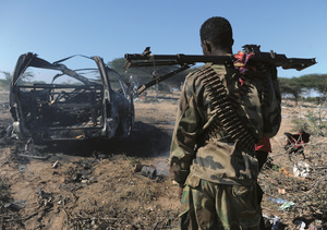 A soldier surveys the wreckage of an al-Shabaab suicide bombing in September 2014.Photo: Mohamed Abdiwahab/AFP/Getty