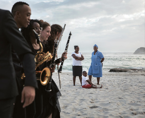 Members of the South African National Youth Orchestra walk on a beach in Cape Town after a performance. Zinhle Mfaba and Nina Cilliers became friends through playing in the orchestra. 'When we're playing together, we're in sync – we're there for a common cause. That brings us together and makes us one,' says Mfaba.Photo: Ilvy Njiokiktjien