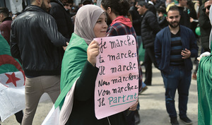 'I march, you march… he leaves.' An Algerian woman takes a stand against 82-year-old President Bouteflika. As a result of mass protests, Bouteflika has decided not to stand for a fifth term.Photo: Ryad Kramdi/AFP/Getty