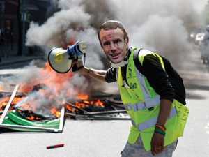 A protester wears a mask of French President Emmanuel Macron crying during a Gilets Jaunes demonstration in Paris, 20 April 2019. Photo: ZAKARIA ABDELKAFI/AFP/Getty