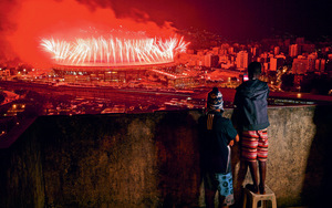 Left out of the big bash: children from Mangueira favela watch fireworks over Maracana Stadium during the closing ceremony.Photo: CARL DE SOUZA/AFP/Getty Images