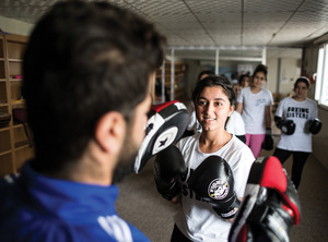 Husna during training with her kickboxing instructor who comes from Dohuk, the nearest city to the camp.Photo: Giacomo Sini