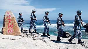 Chinese People's Republic soldiers patrol the Paracel Islands, also claimed by Vietnam and Taiwan. The US asserts its military dominance via naval patrols and bases in the region.Photo: Stringer/Reuters