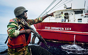 A Liberian soldier, on joint patrol with Sea Shepherd, about to board an illegal shrimper.Photo: Sea Shepherd global