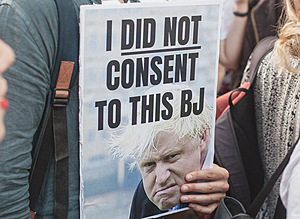 A protester in London makes a risqué pun about the United Kingdom's new prime minister, Boris Johnson.Photo: Chris Bethell