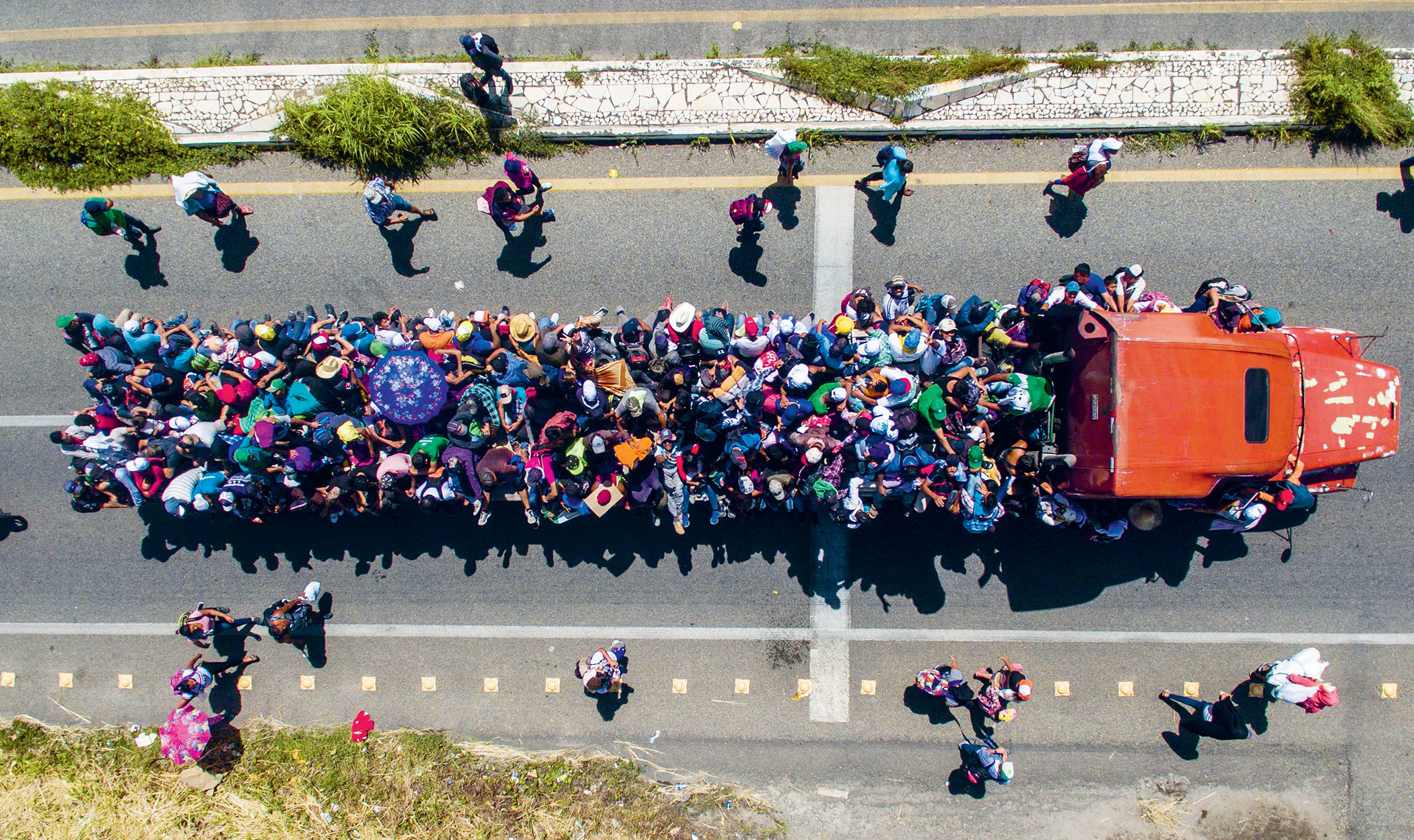 The view from above: Hondurans last year taking part in a caravan heading towards the US border. US policy toward Honduras will set new caravans in motion.