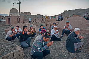 Uyghur men in Xinjiang pray during the Corban festival (Eid) in 2016. Public displays of religiosity are now considered signs of extremism.Photo: Kevin Frayer/Getty