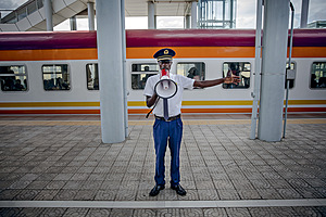 (Previous page) A guard at the Mombasa terminus of the Chinese-financed SGR railway. Saturday is one of the busiest times on the line, as Kenyans travel from Nairobi to the coast to visit family.Photo: Luis Tato/Bloomberg/Getty