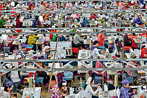 Precarious lives: garment workers, mostly women, make sportswear in Phnom Penh, Cambodia.Photo: Chris Stowers/Panos Pictures