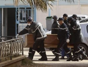 Rescue workers deliver the coffin of one of the hostages to the hospital in the nearby town of Amenas.