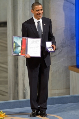 Sinister truths behind the smiles: Obama receiving the Nobel Peace Prize.Scott London / Alamy