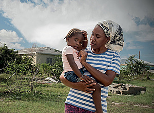 Fifi, with her daughter Mia, bemoans the slow pace of reconstruction.Photo: Tamzin Forster