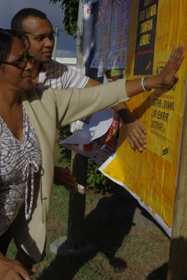 Pasting posters in a campaign for mother-tongue education, introduced for the first time in 2012