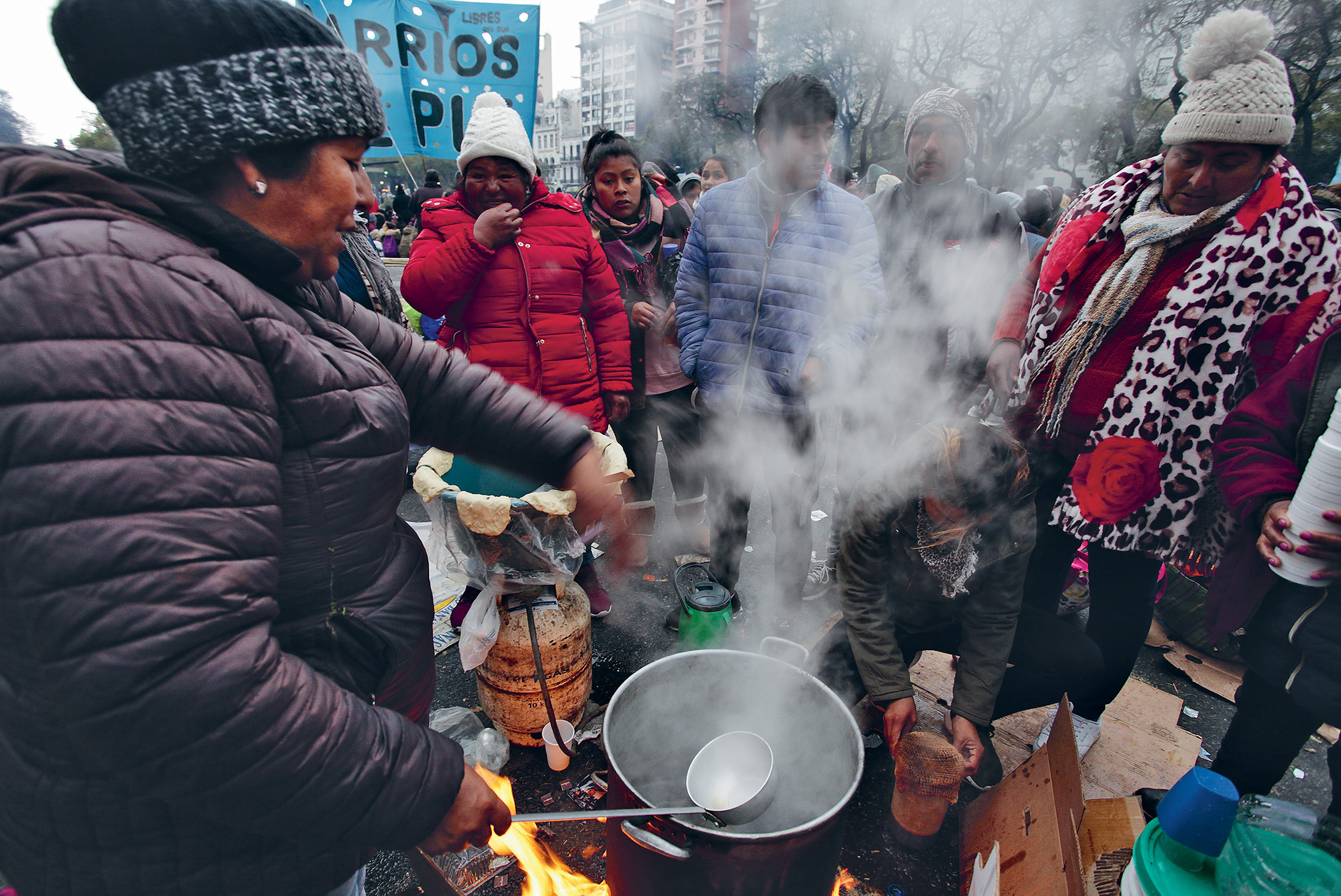 Protesters against Argentina's hunger crisis gather for a brew, 5 September 2019. They had camped out overnight in front of the Ministry of Social Development in Buenos Aires.