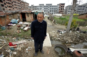 Lone defiance: demanding proper compensation, farmer Xiang Wen Jiang resists eviction and the demolition of his house in the town of Gushi, Henan Province.David Gray / Reuters