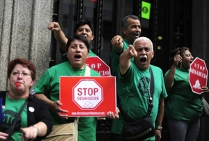 Stop evictions! Protesters signal their anger outside a bank in Barcelona.Manu Fernandez / AP Photo