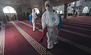 Exit denied: Palestinian workers disinfect a mosque as a preventive measure amid fears of the spread of coronavirus, in Gaza, which is under blockade by Israel.Photo: Majdi Fathi/Nurphoto/PA