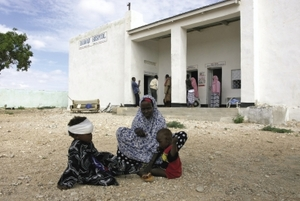Resting for a bit, after treatment by doctors at the Daawad hospital in Eyl, Somalia, before beginning the return journey home.Frederic Courbet/Panos Pictures