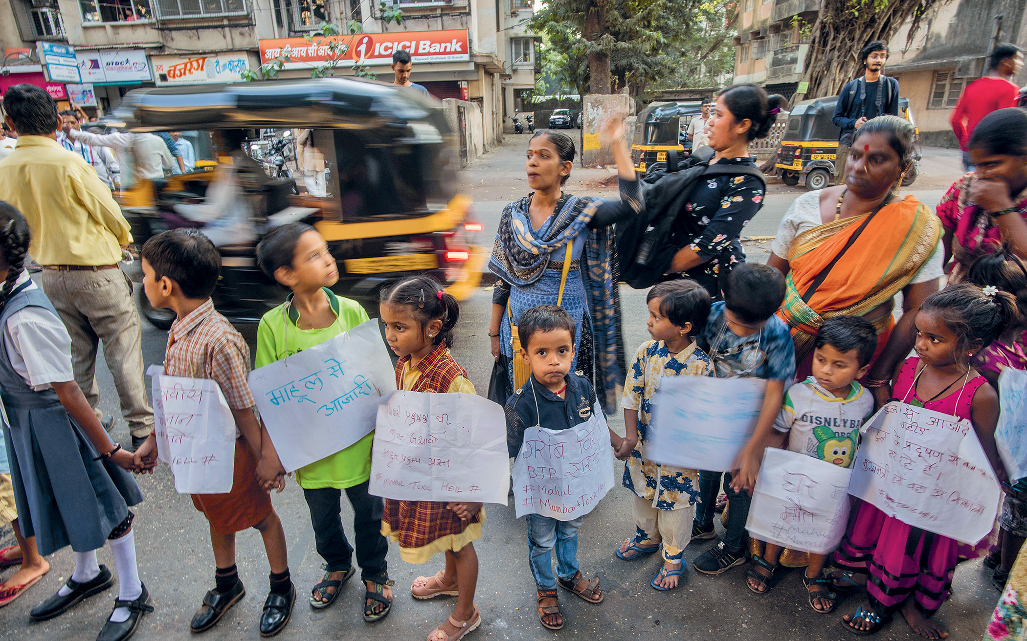Children join with residents of Mahul to form a human chain as part of an International Human Rights Day protest against the government.