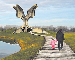 A father and his young daughter visit the Stone Flower monument at Jasenovac. Designed by the famous Serb architect Bogdan Bogdanović, it is a memorial to the victims of Ustasha atrocities during the Second World War.Photo: Ferdinando Piezzi/Alamy